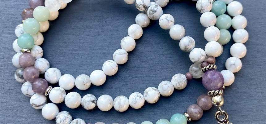 What do white beads symbolize